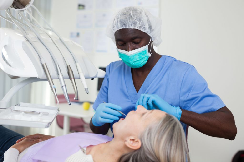 Doctor performing tooth exposure procedure - Stanislaus Oral Surgery, Modesto, CA