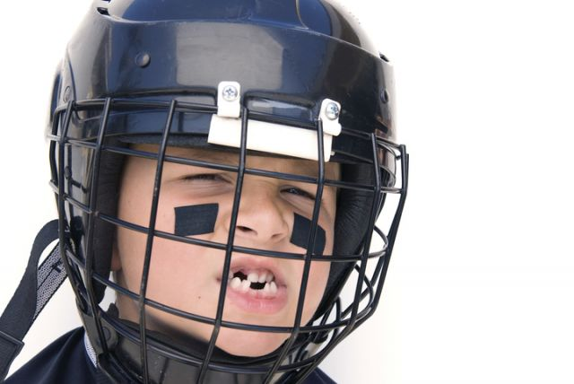 Boy in football helmet - Stanislaus Oral, Modesto, CA