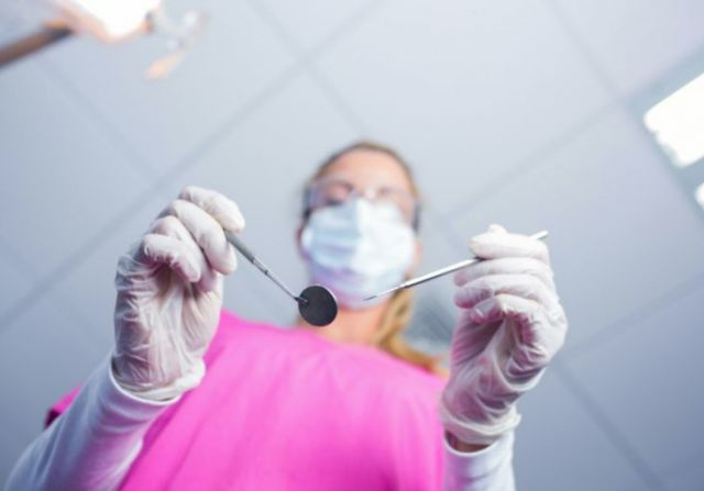 Dentist in Surgical Mask Holding Tools - Anesthesia Modesto, CA