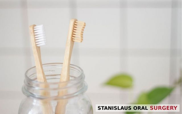 Two clean toothbrushes on a glass jar - Modesto, CA